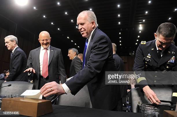 CIA Director John Brennan Director of National Intelligence James Clapper FBI Director Robert Mueller and Defense Intelligence Agency Director Lt Gen...
