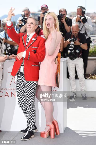 Director John Cameron Mitchell and Actress Elle Fanning attend the How To Talk To Girls At Parties photocall during the 70th annual Cannes Film...