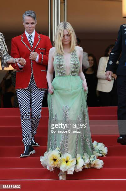 Director John Cameron Mitchell and actress Elle Fanning depart after the 'How To Talk To Girls At Parties' screening during the 70th annual Cannes...