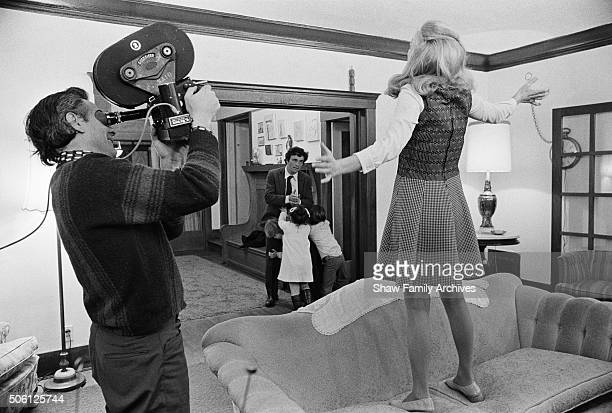 Director John Cassavetes with actors Peter Falk and Gena Rowlands in 1973 during the filming of A Woman Under the Influence in Los Angeles California