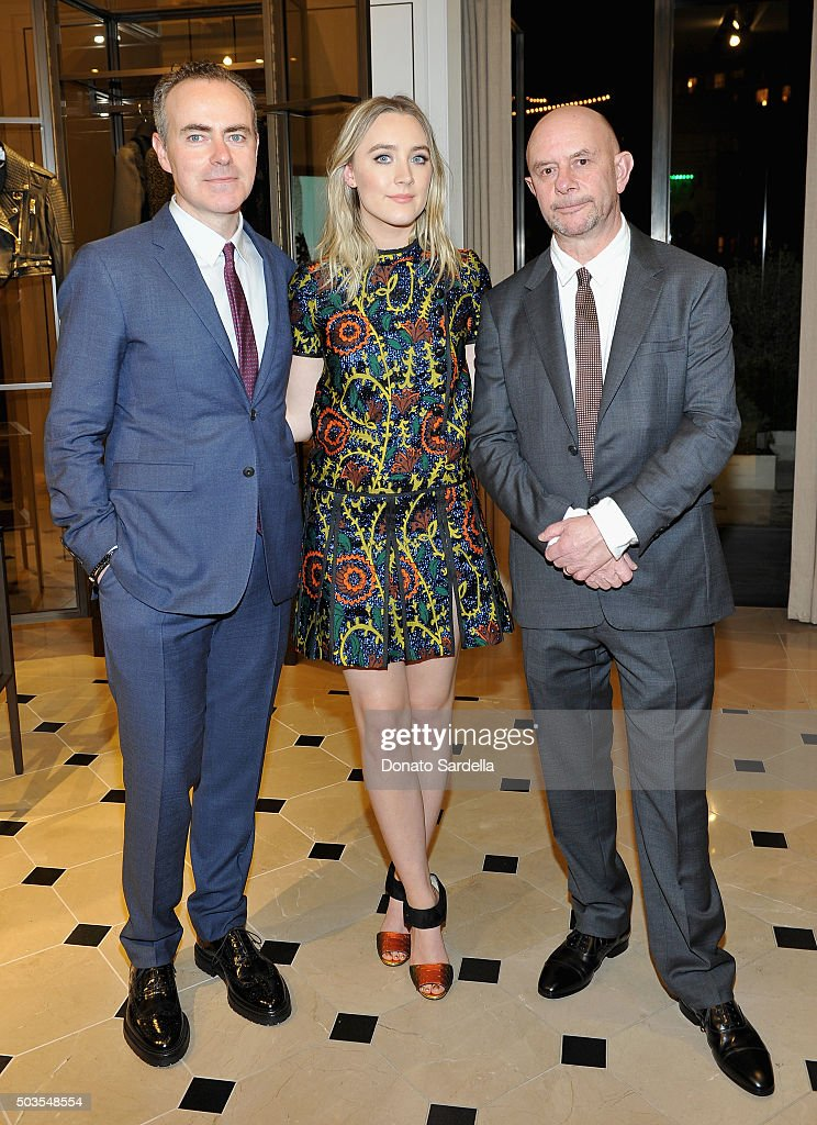 Director John Crowley, actress Saoirse Ronan and screenwriter Nick Hornby, all wearing Burberry, at Burberry and Fox Searchlight Pictures honour the cast and filmmakers of 'Brooklyn' at Burberry on January 5, 2016 in Beverly Hills, California.