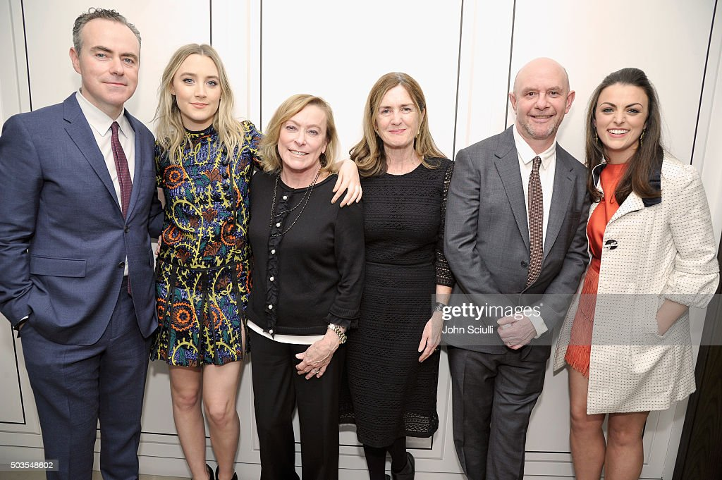 Director John Crowley and actress Saoirse Ronan, both wearing Burberry, President, Fox Searchlight Pictures, Nancy Utley, producer Finola Dwyer and screenwriter Nick Hornby, both wearing Burberry, and actress Nora-Jane Noone at Burberry and Fox Searchlight Pictures honour the cast and filmmakers of 'Brooklyn' at Burberry on January 5, 2016 in Beverly Hills, California.