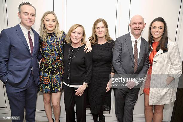 Director John Crowley and actress Saoirse Ronan both wearing Burberry President Fox Searchlight Pictures Nancy Utley producer Finola Dwyer and...