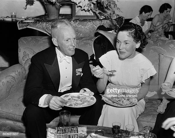 Director John Farrow and wife actress Maureen O'Sullivan attend a party at actor Alan Mowbray home in Los Angeles California