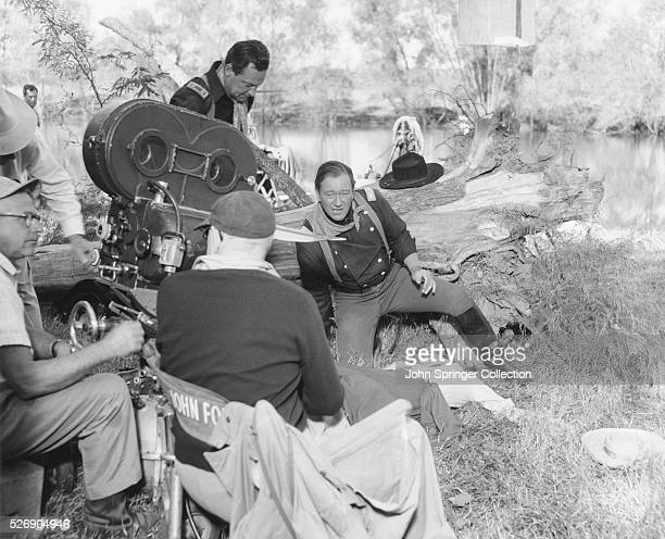 Director John Ford and actors John Wayne and William Holden in costume during the filming of the 1959 motion picture The Horse Soldiers Wayne starred...