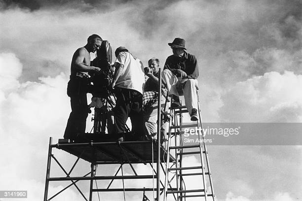 Director John Ford and his film crew setup for the filming of a scene while on location in Hawaii for 'Mister Roberts' a Warner production