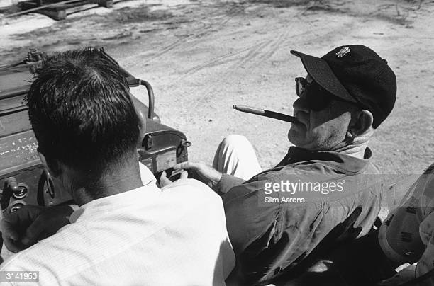 Director John Ford on location for the filming of 'Mister Roberts' in Hawaii