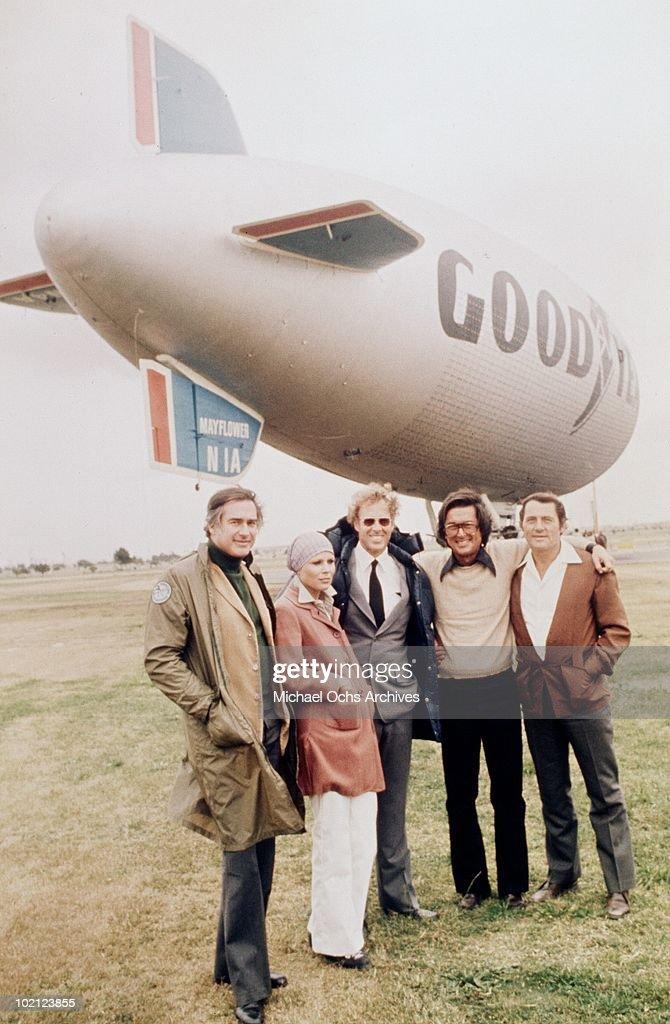 Director John Frankenheimer, Marthe Keller, Bruce Dern, producer Robert Evans and Robert Shaw pose for a portrait on the set of the movie 'Black Sunday' in 1977 in Carson, California.