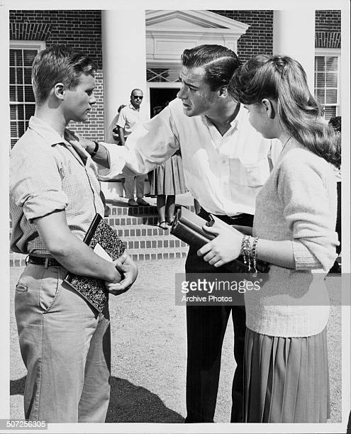 Director John Frankenheimer talking to actors Brandon de Wilde and Bernadette Withers, on the set of the movie 'All Fall Down', circa 1962.