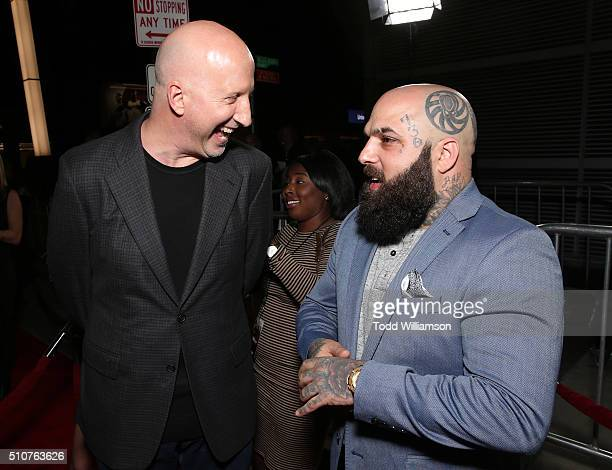 Director John Hillcoat and Carlos Aviles attend the premiere Of Open Road's Triple 9 at Regal Cinemas LA Live on February 16 2016 in Los Angeles...