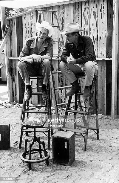Director John Huston with actor Clark Gable during the filming of 'The Misfits' on location in the Nevada Desert