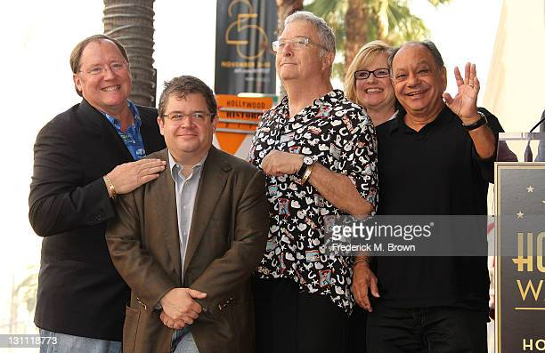 Director John Lasseter actor Patton Oswalt composer Randy Newman actress Bonnie Hunt and actor Cheech Marin pose for photographers during the...