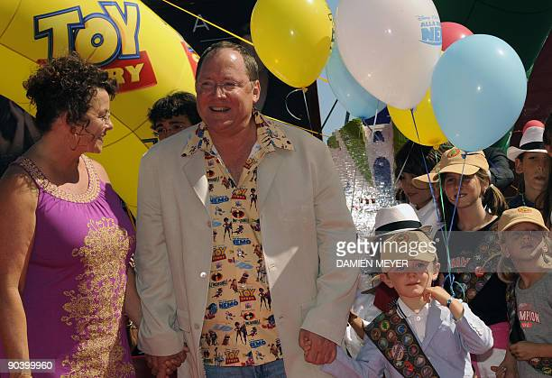 Director John Lasseter and his wife Nancy arrive for the Golden Lion for the Lifetime Achievement ceremony at the Venice film festival on September...