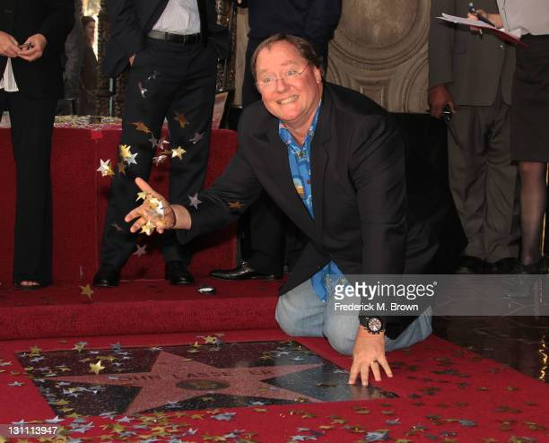 Director John Lasseter poses during the ceremony honoring him with a Star on The Hollywood Walk of Fame on November 1 2011 in Hollywood California
