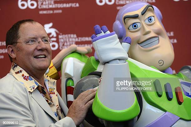 """Director John Lasseter poses with Toy Story hero """"Buzz Lightyear"""" during the photocall for the Golden Lion for Lifetime Achievement at the Venice..."""
