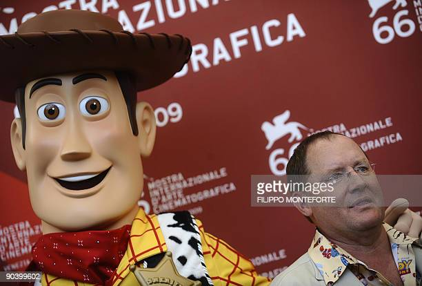 """Director John Lasseter poses with Toy Story hero """"Woody"""" during the photocall for the Golden Lion for Lifetime Achievement at the Venice film..."""