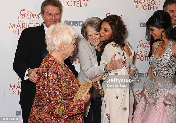 Director John Madden Dame Judi Dench Dame Maggie Smith Lillete Dubey Tena Desae and Ol Parker attend The Royal Film Performance and World Premiere of...