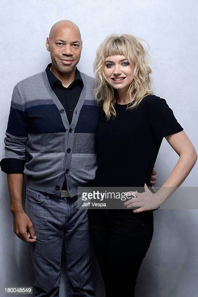 Director John Ridley and actress Imogen Poots of 'All By My Side' pose at the Guess Portrait Studio during 2013 Toronto International Film Festival...