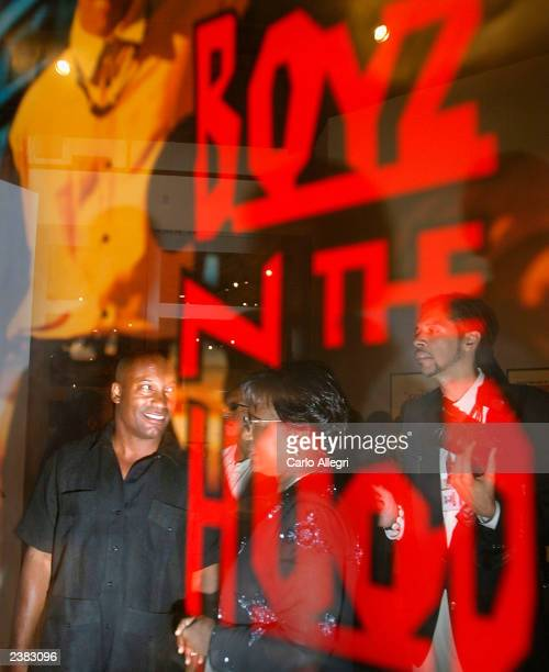 Director John Singelton is reflected in a poster for his movie Boyz n the hood as he visits an exibition of African American film posters at the...