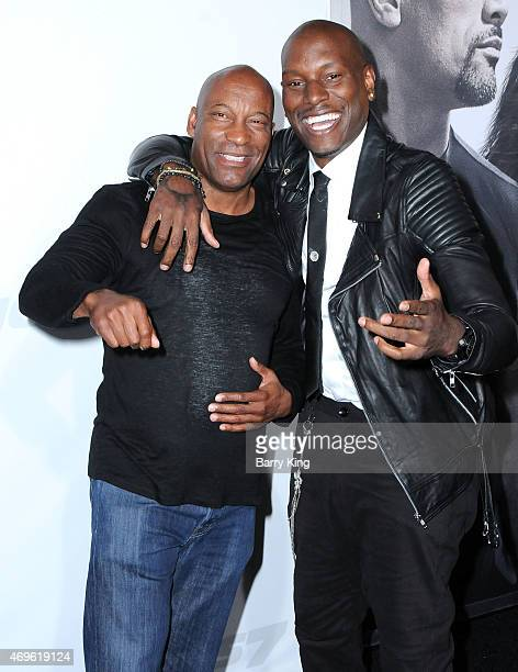 Director John Singleton and actor Tyrese Gibson arrive at the Los Angeles Premiere 'Furious 7' at TCL Chinese Theatre IMAX on April 1 2015 in...