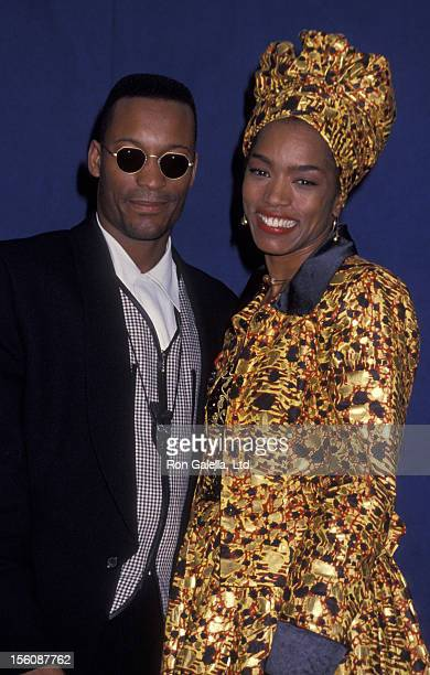 Director John Singleton and actress Angela Bassett attending 25th Annual NAACP Image Awards on January 16 1993 at the Pasadena Civic Auditorium in...