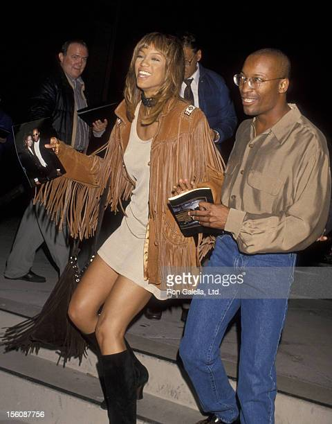 Director John Singleton and model Tyra Banks attending Los Angeles screening of 'Carlito's Way' on November 9 1993 at the Director's Guild Theater in...