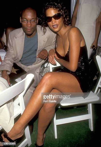 Director John Singleton and Model Veronica Webb attend the 1995 Fresh Air Fund Salute To American Heroes Gala on June 8 1995 at Tavern on the Green...