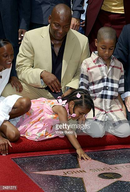 Director John Singleton and relatives attend a ceremony honoring him with a star on the Hollywood Walk of Fame in front of Mann's Chinese Theatre...