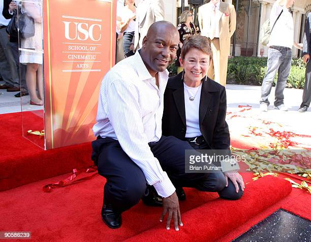 Director John Singleton and SCA Dean Elizabeth M Daley attend 'Hollywood Chamber of Commerce Star Commemoration' at University of Southern California...