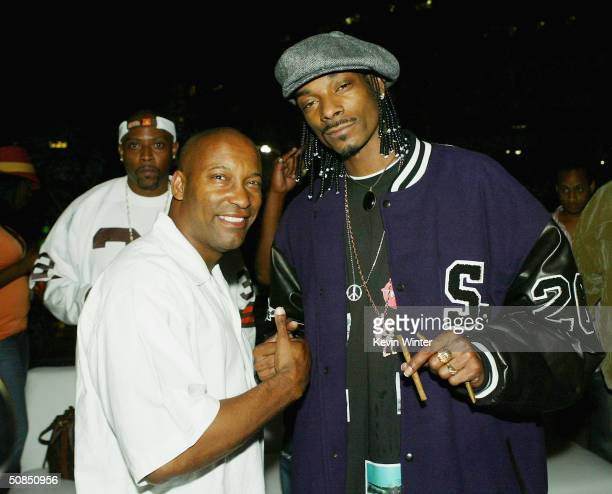 Director John Singleton and Snoop Dogg pose at the afterparty for MGM's Soul Plane at the Hammer Museum on May 17 2004 in Los Angeles California