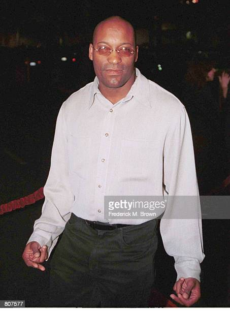 Director John Singleton arrives for the film premiere of Once In The Life at the Magic Johnson Theatre on October 25 2000 in Los Angeles CA