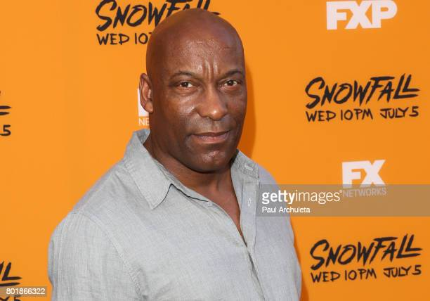 Director John Singleton attends the premiere of FX's Snowfall at The Theatre at Ace Hotel on June 26 2017 in Los Angeles California