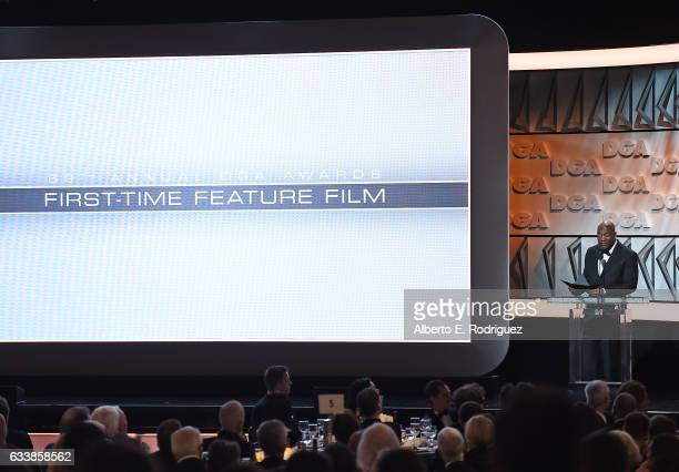 Director John Singleton presents the FirstTime Feature Film Plaque onstage during the 69th Annual Directors Guild of America Awards at The Beverly...