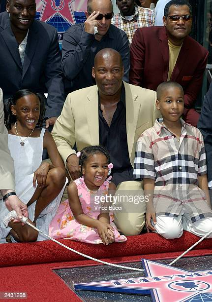 Director John Singleton relatives and actors Actor Tyrese Gibson producer Neal Moritz and actor/director Laurence Fishburne attend a ceremony...