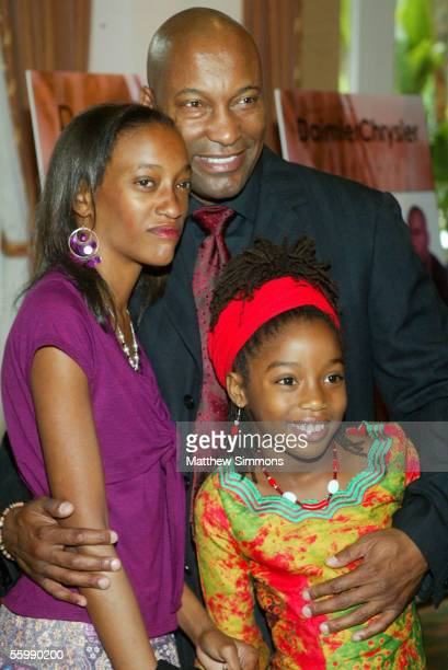 Director John Singleton with daughters Justice and Hadara Singleton attends the DaimlerChrysler 2005 Behind The Lens awards ceremony at the Beverly...