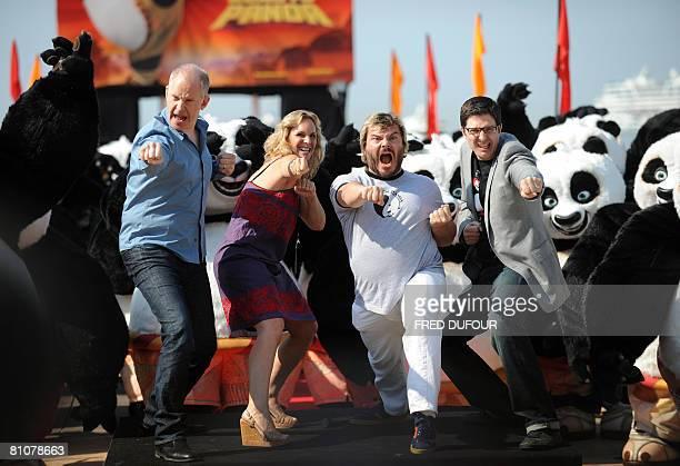 US director John Stevenson producer Melissa Cobb actor Jack Black and US director Mark Osborne perform surrounded by dozens of people in panda...