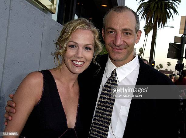 US director John Swanbeck poses with actress Jennie Garth fiancee of the film's star Peter Facinelli in Hollywood CA 26 April 2000 The film also...
