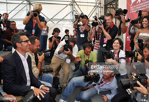 Director John Turturro sits with the photographers as he attends the Passione photocall during the 67th Venice Film Festival at the Palazzo del...