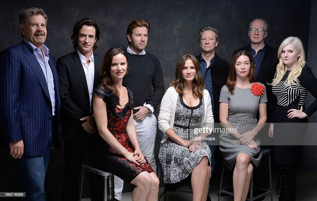 Director John Wells, actor Dermot Mulroney, actress Juliette Lewis, actor Ewan McGregor, actress Julia Roberts, actor Chris Cooper, actress Julianne Nicholson, screenwriter Tracy Letts and actress Abigail Breslin of 'August: Osage County' pose at the Guess Portrait Studio during 2013 Toronto International Film Festival on September 10, 2013 in Toronto, Canada.