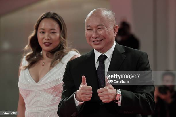 director John Woo and actress Angeles Woo attend the premiere of the movie 'Zhuibu' presented out of competition at the 74th Venice Film Festival on...