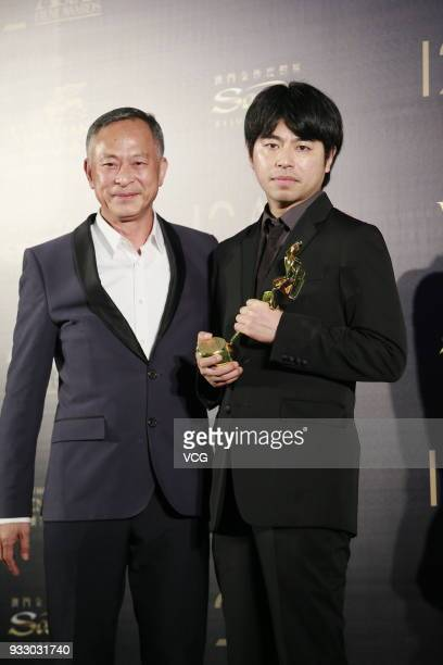 Director Johnnie To Kei Fung and Japanese director Yuya Ishii pose backstage during the 12th Asian Film Awards at the Venetian Hotel on March 17 2018...