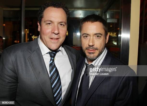 Director Jon Favreau and actor Robert Downey Jr attend the afterparty for 'Iron Man' hosted by The Cinema Society and Michael Kors at The Odeon on...