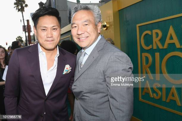 Director Jon M Chu and Warner Bros Entertainment CEO Kevin Tsujihara arrive at Warner Bros Pictures' Crazy Rich Asians Premiere at TCL Chinese...