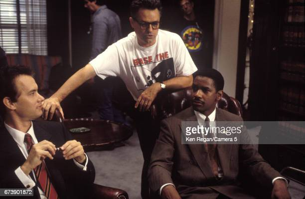 Director Jonathan Demme and actors Tom Hanks and Denzel Washington are photographed on the set of 'Philadelphia' in 1992 in Philadelphia Pennsylvania...