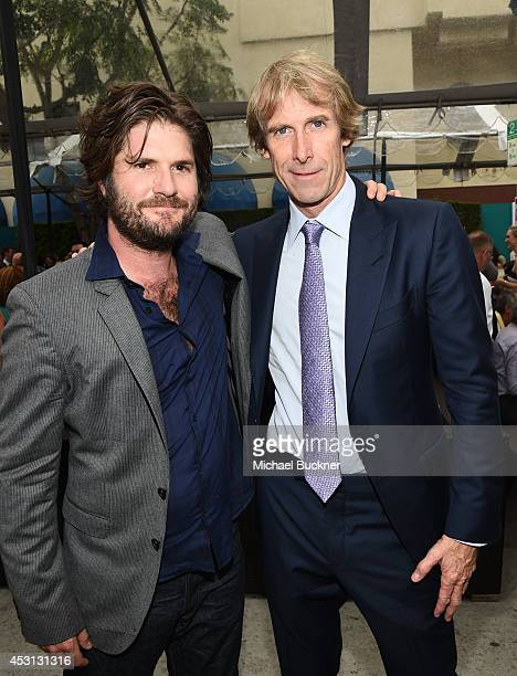 Director Jonathan Liebesman and producer Michael Bay attend the premiere of Paramount Pictures' Teenage Mutant Ninja Turtles block party on August 3...