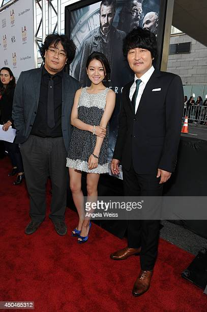 Director Joonho Bong actors Ahsung Ko and Kangho Song attend the opening night premiere of 'Snowpiercer' during the 2014 Los Angeles Film Festival at...
