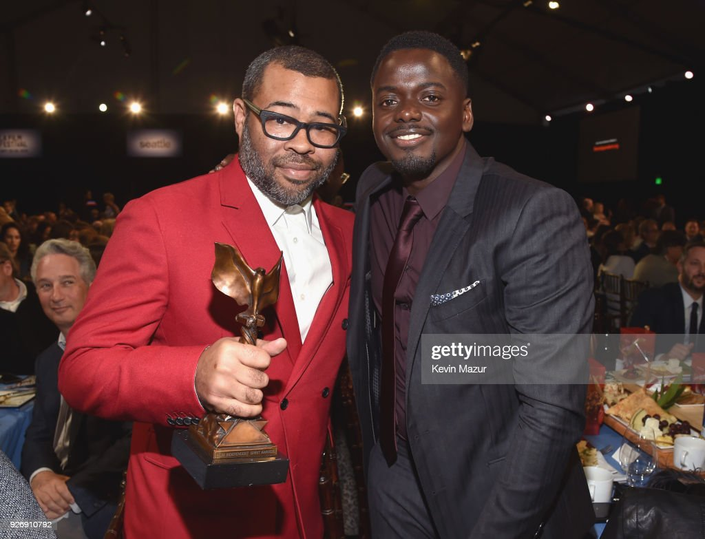 Director Jordan Peele (L) and actor Daniel Kaluuya pose with the award during the 2018 Film Independent Spirit Awards on March 3, 2018 in Santa Monica, California.