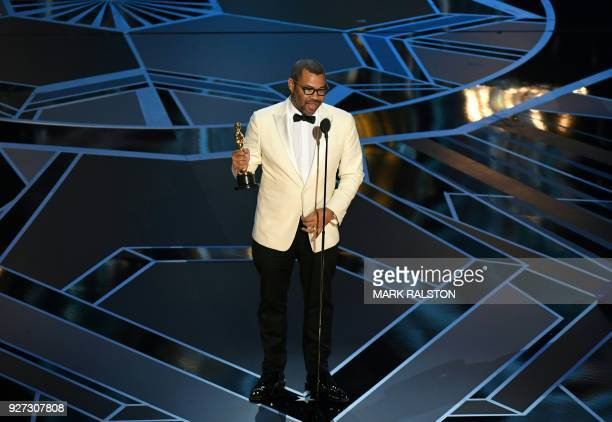 Director Jordan Peele delivers a speech after he won the Oscar for Best Original Screenplay for 'Get Out' during the 90th Annual Academy Awards show...