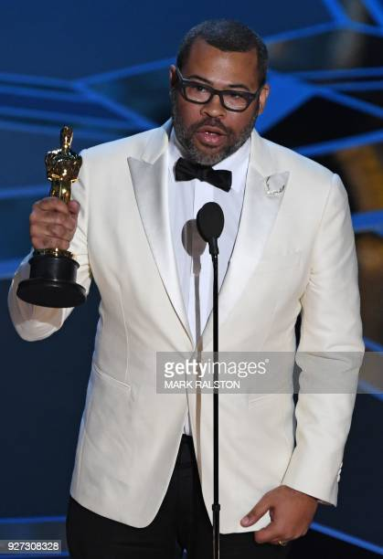 """Director Jordan Peele delivers a speech after he won the Oscar for Best Original Screenplay for """"Get Out"""" during the 90th Annual Academy Awards show..."""