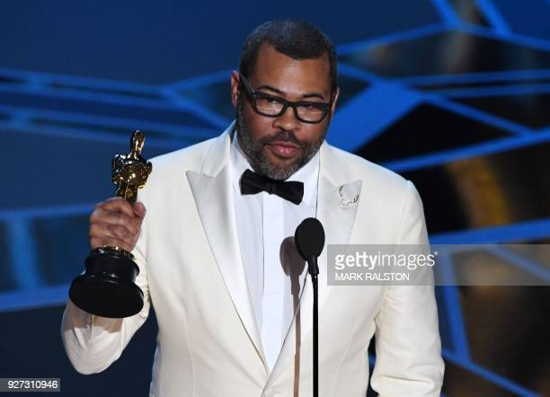TOPSHOT Director Jordan Peele delivers a speech after he won the Oscar for Best Original Screenplay for 'Get Out' during the 90th Annual Academy...